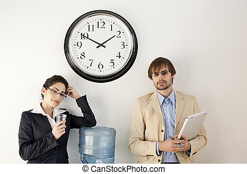 Businesspersons at Water Cooler - Male and female...