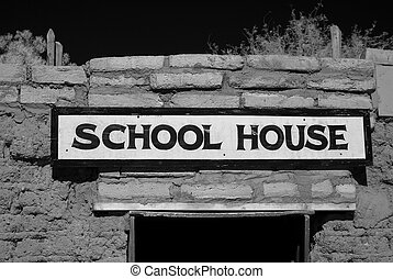 Old School House - Old adobe brick school house with sign