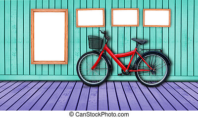 red bicycle on color wooden house wall