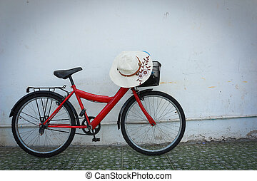 red bicycle on old dirty house wall,vintage style