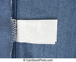 macro of blank tag on blue jeans background