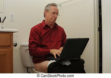 workaholic - Man on toilet working on computer