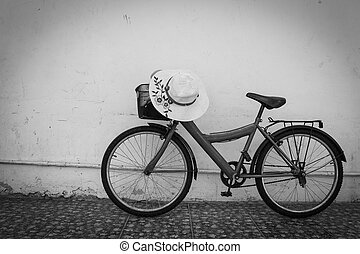 red bicycle - bicycle on black and white  old  house wall.