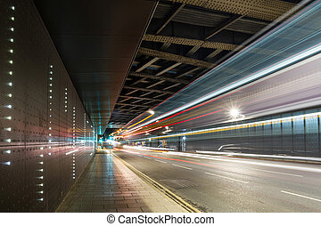 Segments of Leeds - Bus trails lead in to a railway tunnel,...