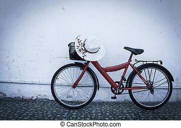 red bicycle on old dirty  house wall,vintage style.