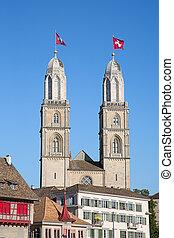 Zurich in summer - Famous Grossmuenster church in Zurich,...