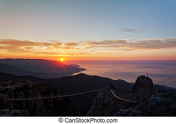 Beautiful sunrise over the Black Sea, a view from mountain...