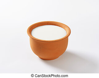 Bowl of fresh buttermilk - Fresh buttermilk in terracotta...