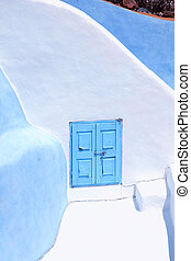 Detail of the typical blue and white house in Oia, Santorini...