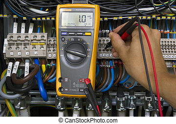 Electrical measurement - Electrician performing voltage...