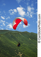 Paragliding solo under clouds