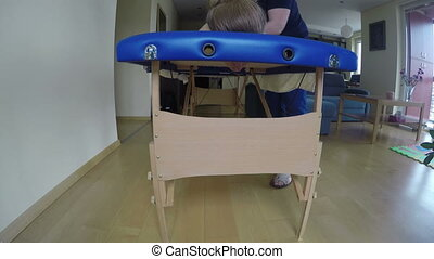 woman lie table massage - Woman lie on comfortable blue...