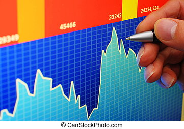 financial stock market concept with hand and computer lcd...