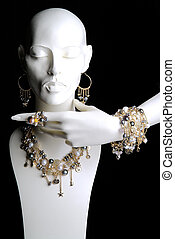 Mannequin with Jewelry Rings Bracelets Necklaces and Earrings