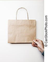Mockup of craft shopping bag. - Mock up of craft square bag...