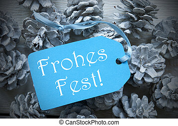 Light Blue Label On Fir Cones Frohes Fest Means Merry Christmas