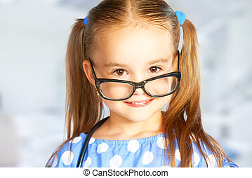 funny smiling child girl in glasses - A funny smiling child...