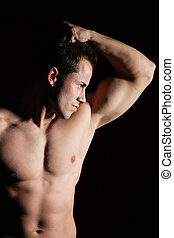 Sexy muscular man isolated on white - A Sexy muscular man on...
