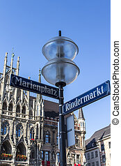 New city hall of Munich at Marienplatz with street sign in front