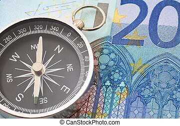 euro money and compass showing financial success
