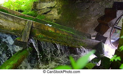 Rustic Hydroelectric Generator - Close up on a rustic...