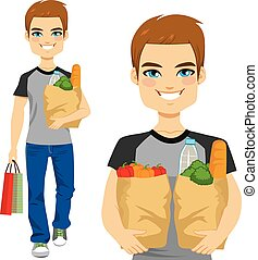 Man Carrying Grocery Bag - Happy young man carrying grocery...