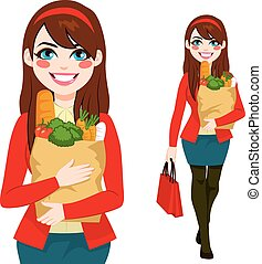 Woman Carrying Grocery Bag - Beautiful brunette young woman...