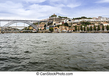 Panoramic from Douro river tour boat, view of Dom Luiz...