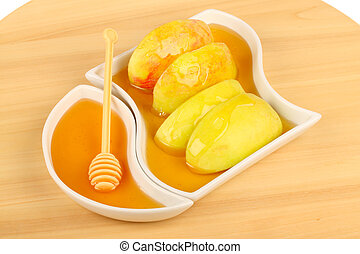 Dipping apples in honey for Rosh HaShana, the Jewish New...