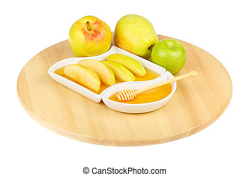Dipping apples in honey - apples and dipping slices of apple...