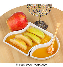 apple and honey - apples and dipping slices of apple in...