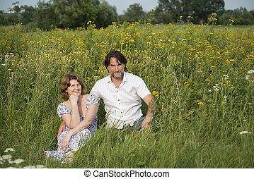 Loving couple relaxing on a meadow - A Loving couple...