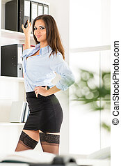 Sexy Secretary With Binders - Pretty young business woman in...