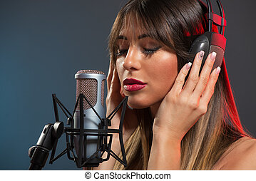 Woman Singer Recording A Ballad - Beautiful young woman...