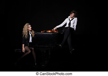 Two beautiful young women with violon and piano - Two...