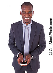 Portrait of a young African American business man using