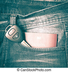 passport in jean pocket with car key retro vintage style