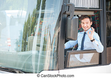 Handsome fit young driver is gesturing positively - Cheerful...