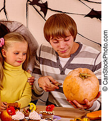 Family with child holding make carved pumpkin - Father with...