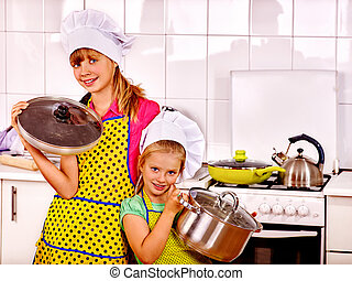 Children cooking at kitchen - Children wearing hat and apron...