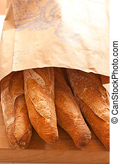 paper bag of baguettes - bag of baguettes