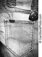 passport in jean pocket with car key black and white tone...
