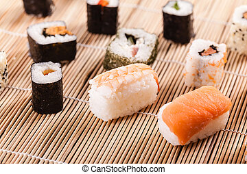Sushi course - an assortment of different sushi pieces on a...