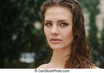 Natural female beauty in summer rain