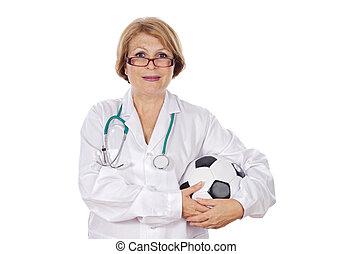 Doctor holding soccer ball