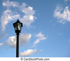 Streetlight - An old-fashioned streetlight against a cloudy,...