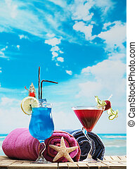 Blue lagoon and strawberry daiquiri on the beach - Blue...
