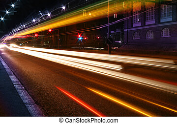 Night lights on street - Beams of light made by city traffic...