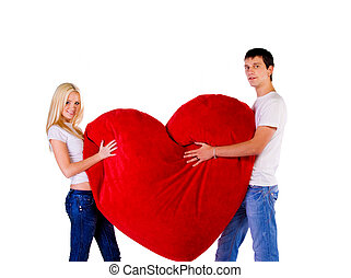 Young couple with a big red heart - Young couple with a big...