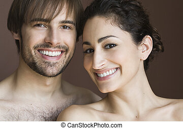 Young Couple - Young couple posing topless front facing....